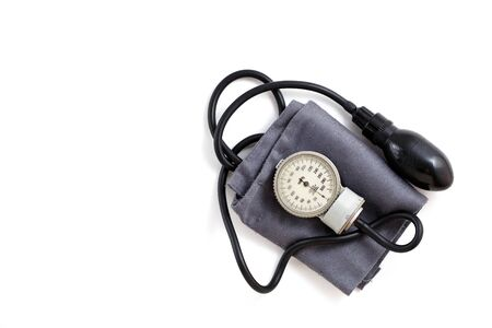 vintage tonometer on white isolated background Фото со стока