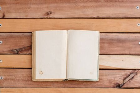 sheets of book with empty space on wooden background