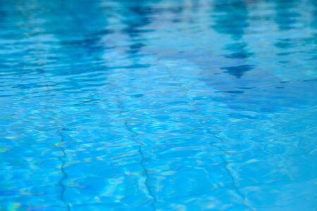 water in the pool with sun glare on a hot summer day Stock Photo