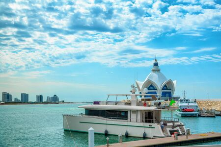 background of blue sky with beautiful clouds and azure sea with Marina and yachts. the focus is selective. Stok Fotoğraf