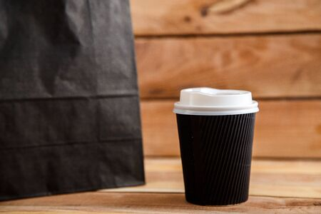 cardboard biodegradable eco-friendly cups on a wooden background