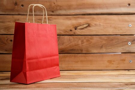 biodegradable environmentally friendly cardboard bag on wooden background