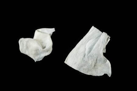 a crumpled paper napkin on a black insulated background. on the glass 写真素材