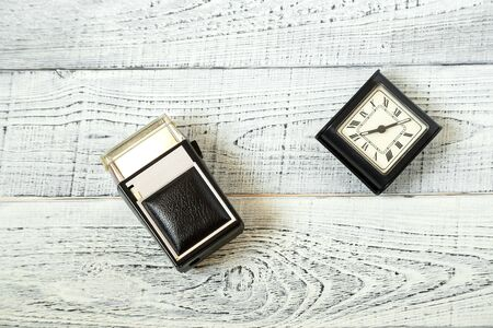 morning. vintage electric shaver and retro alarm clock on shabby white wooden background Фото со стока - 131227022