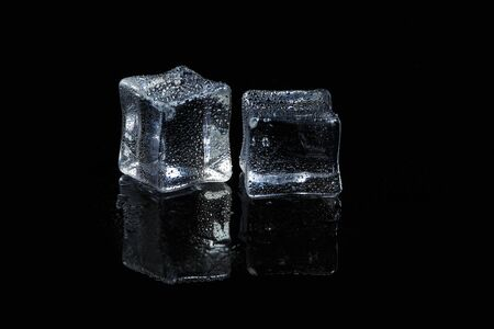 ice cubes on black isolated glass background