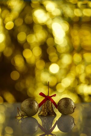 Christmas toy on a background of Golden background with beautiful bokeh Reklamní fotografie - 133067511