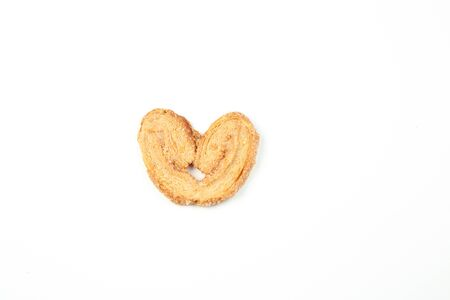 layered shortbread cookies on white isolated background