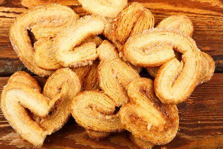 multiple layered shortbread cookies on wooden background Banco de Imagens