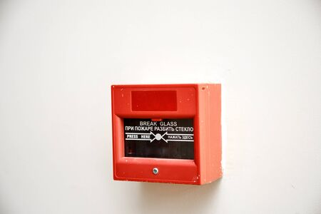 fire alarm button . with inscription in English and translation into Russian