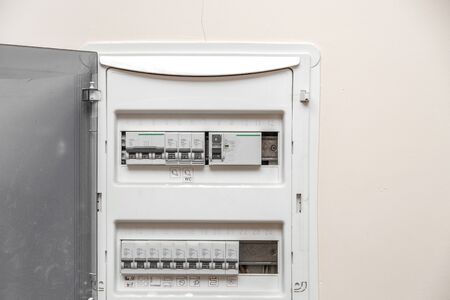 Electricity distribution box. Fusebox. Isolated on apartment wall Banco de Imagens