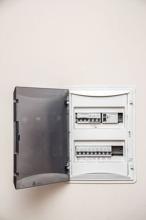 Electricity distribution box. Fusebox. Isolated on apartment wall Stock Photo