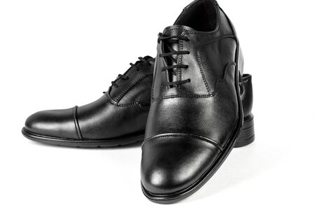 black leather shoes on a white isolated background Standard-Bild