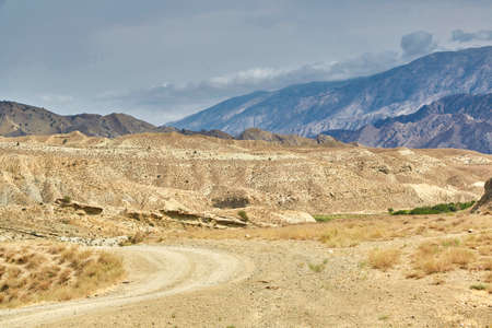 a sandy road in the mountains of Asia. sand surface dried without rain.