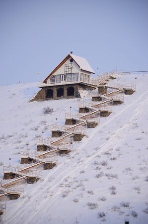 the house on snow mountain accessed by a staircase Sajtókép