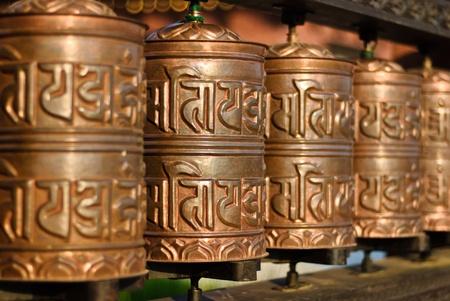 tibetian: Tibetian prayer wheels. Selective focus Stock Photo