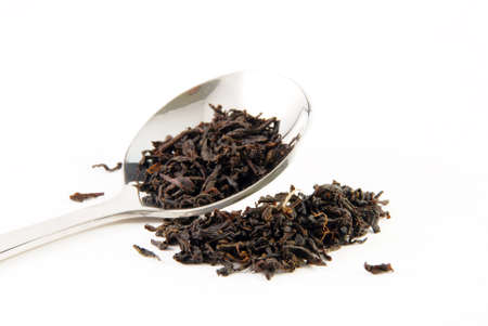 Tea leaves, a teaspoon photo