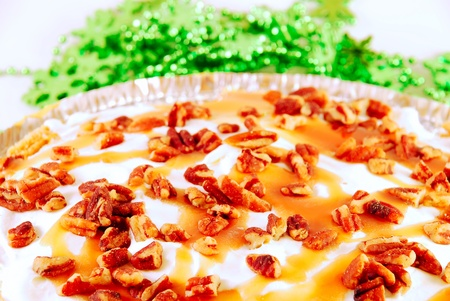 Pumpkin pie with nuts and caramel photo