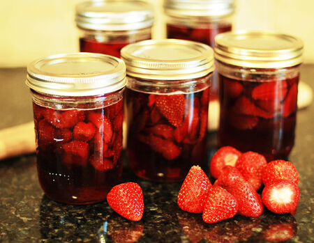 Fresh hot red strawberry jam cooking process