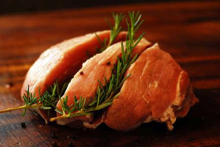 Raw, red, fresh meat pork on a cutting board.