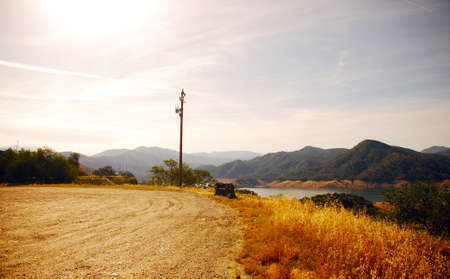 Road in California surrounded by deserts and mountains with trees photo
