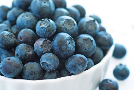 Blue ripe fresh blueberries in a beautiful bowl. photo