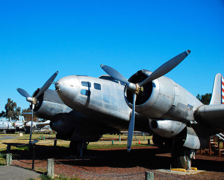 Old military aircraft on the airfield against the sky