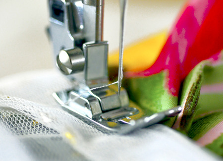 Sewing machine with a needle and thread connects cloth.