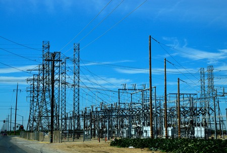 amp tower: Powerhouse with strong metal wires in the field  Stock Photo