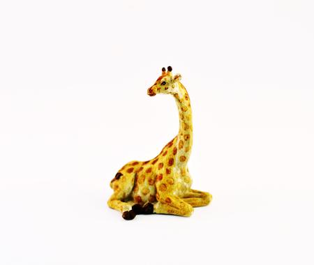 Ceramic figurine of a giraffe on a white background. photo
