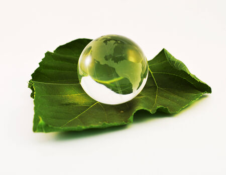 Glass paperweight crystal clear color on a white background. photo