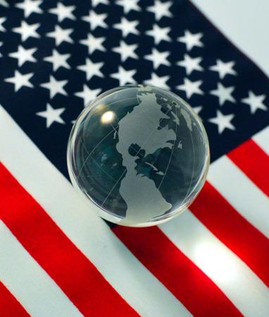 Glass ball globe on American flag background. photo