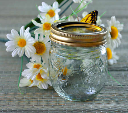 Empty glass jar for preservation on the table.