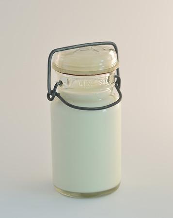 milkman: American vintage milk bottle on a white background.