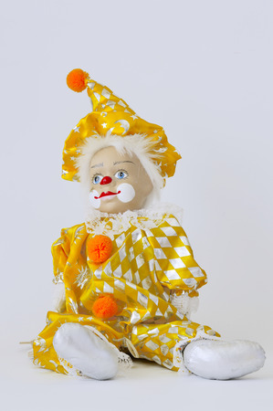 Clown in colored clothing and white hair on a white background Stock Photo