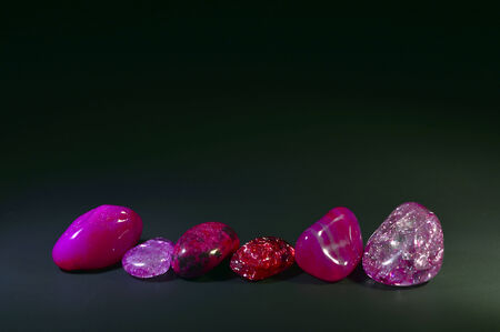 Stones colored crystals on a black background.