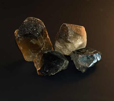 crystalline: Smoky quartz crystal on a black background.