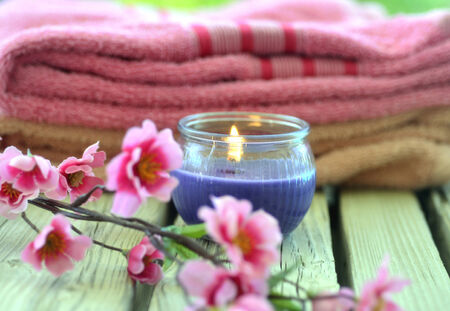 Towel candle flowers on a wooden background. photo