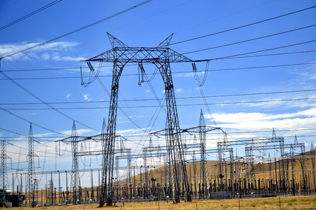 Power lines in California blue sky background.