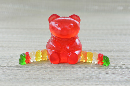 Giant gummy bear candy sweet big red. Stock Photo
