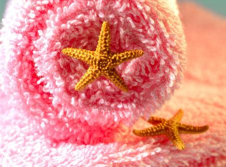 Spa salon towel shell aromatherapy treatment relaxation. photo
