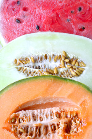 Cantaloupe melon slices of fresh juicy yellow red green.