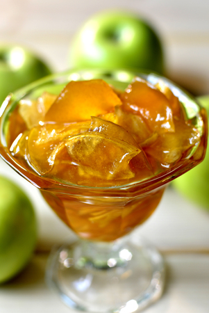 Beautiful fresh apple jam in a glass on the table. photo