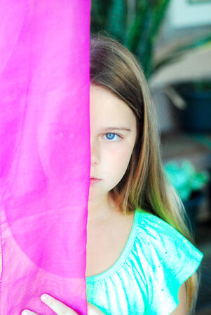 Young girl with colored beautiful fashionable scarf. photo