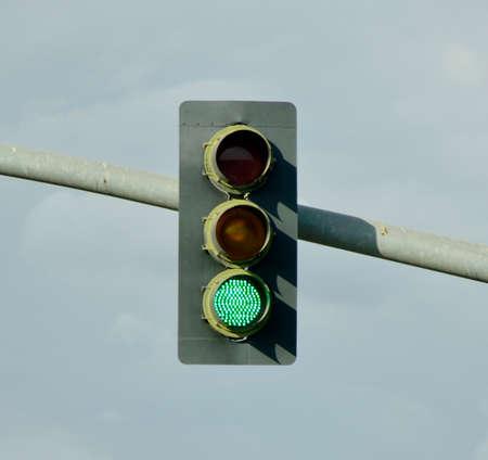 Stop light green light for pedestrians in California.