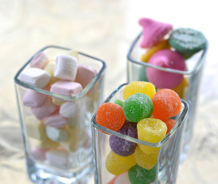 Candy mix multicolored candies in beautiful glasses on the table. photo