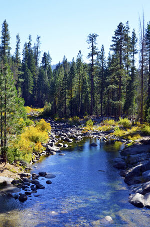 Mountain river with cool blue clear water in the mountains of California. photo