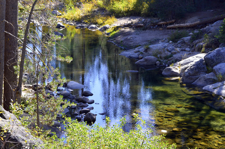 Mountain river with cool blue clear water in the mountains of California.