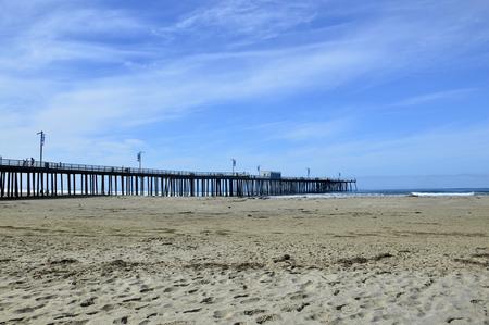 oceanfront: Pismo Beach Pier large wooden oceanfront in California. Stock Photo