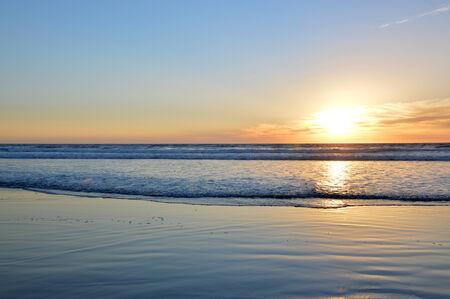 Sunset ocean  cool water  beautiful sun in the sky. photo