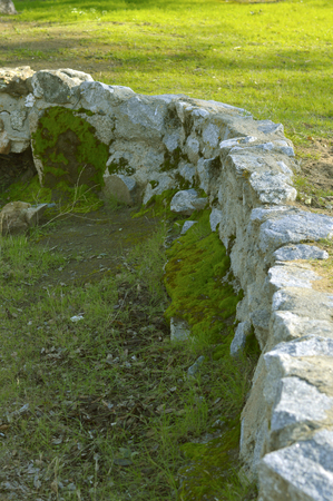 middle joint: Stone fence in the park green grass outdoors